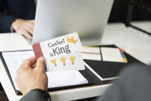 Phrase Content is king written on a sticky note
